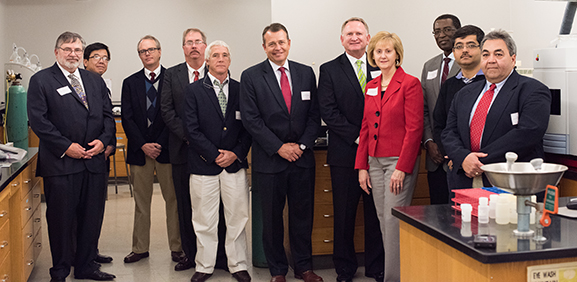 University of Alabama faculty and Waste Management officials