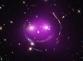 The x-ray image superimposed over the optical image creates the purplish smile of The Cheshire Cat Galaxy Group.