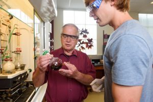 Arduengo and German exchange student Philip Maximilian Knaff work in a UA lab.
