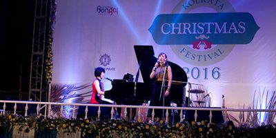 Dr. Susan Williams singing at a concert in Kolkata.