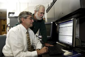Dr. Kenneth Lichstein (left) and Dr. Sid Nau (right) review the electronic record of a patient's polysomnography.
