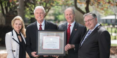 From left, Susan McCollough, Dr. Gaylon McCollough, President Stuart Bell, and Dean Robert Olin